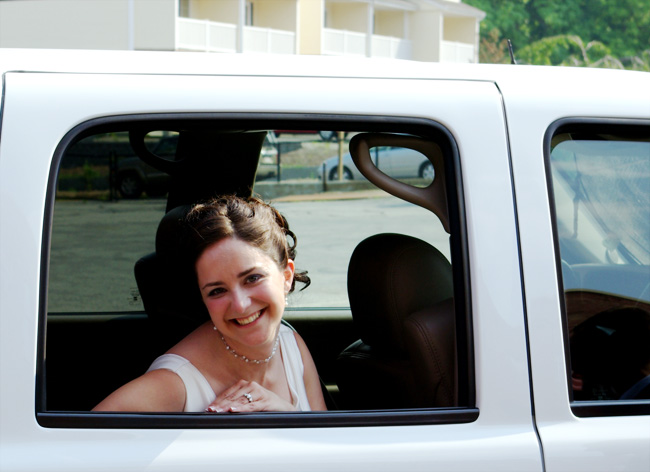 Christina in the car heading to the reception